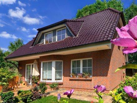 Einfamilienhäuser | Landhaus 156 (Klinkerfassade, Terrassenimpression 2)