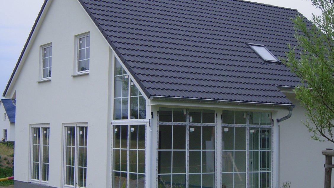 landhaus mit wintergarten hausreferenz einfamilienh user sch neiche roth massivhaus. Black Bedroom Furniture Sets. Home Design Ideas