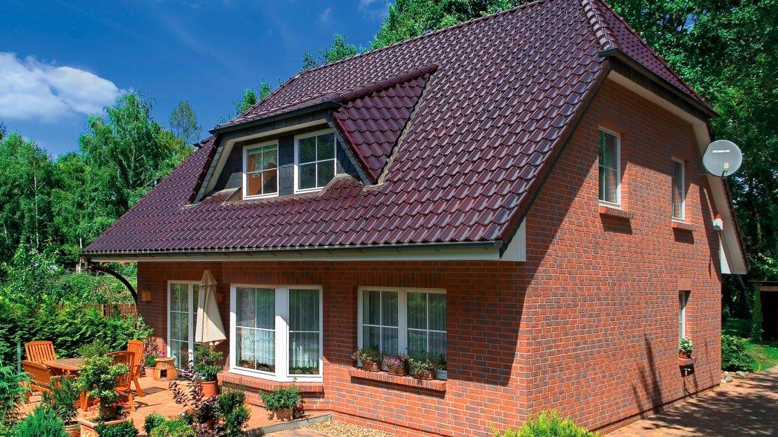 Einfamilienhäuser | Landhaus 156 (Klinkerfassade, Terrassenansicht)